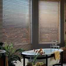 premium 2 1 inch faux wood blinds on one window half