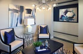 Contemporary living room with modern chandelier and navy blue accent wall