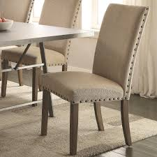 nailhead trim including pad coaster amherst cal parson chair with tan fabric upholstery and s color leather dining room chairs