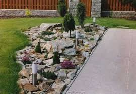 Use rock landscaping for difficult areas near your porch
