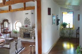 A photo of the interior of a completed home constructed using straw bale  walls. The