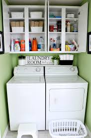 organizing a small laundry room with cabinet shelves storage