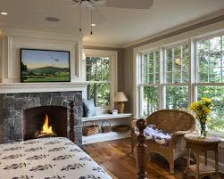 fireplace windows. example of a classic bedroom design in new york with gray walls, standard fireplace windows c