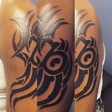 тату козерога в стиле трайбл фото татуировок