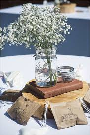 baby s breath and old books wedding centerpieces