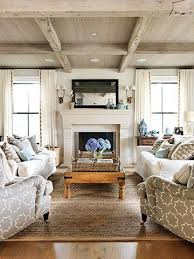 coastal casual living room with weathered wood beams and ceiling jane green via family circle casual living room lots