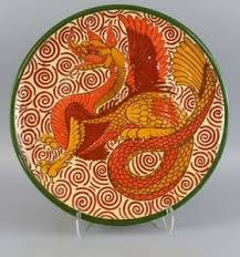 Lot-Art   Studio pottery, by Wendy Mason, Shrewsbury, a large terracotta  charger decorated with a dragon, in the style of William Morris,...