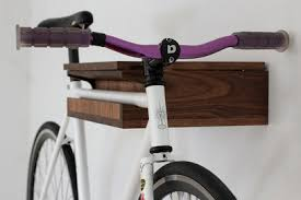 The Bike Valet by Reclamation Art Furniture is a handsome and practical  addition to any cyclist's homethe wall-mounted storage unit features  compartments ...