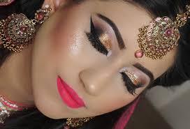 real bride enement nikaah asian bridal makeup gold smokey eyes and bright pink lipstick zero line group