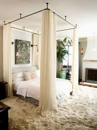 romantic master bedroom with canopy bed. Elegant Fur Rug With Shining White Curtain For Romantic Master Bedroom Makeovers Excellent Fireplace Canopy Bed O