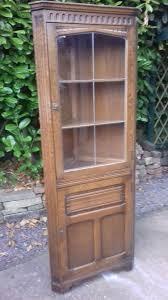 oak corner display cabinet with leaded glass door cupboard below both doors have locks