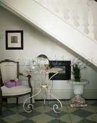 chair for stairs. Table And Chair Under Stairs In Entrance Hall For S