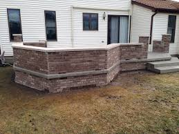 raised stamped concrete patio with decorative brick walls