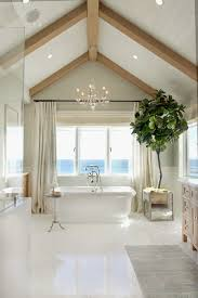 bathroom exposed ceiling lighting bath. house of turquoise bliss home and design white bathroom with vaulted ceiling cool fiddleleaf fig plant tree exposed lighting bath