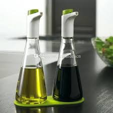 olive oil and vinegar dispenser of 2 oil and vinegar push on dispenser bottle sprayer lead free glass cruet bottles with silicone tray green orange from