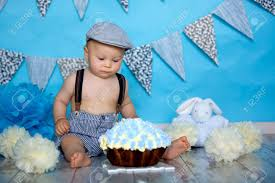 Little Baby Boy Celebrating His First Birthday With Smash Cake