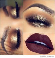 gold glitter eye makeup with brown matte lips