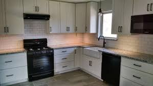 Small Picture POLL white cabinets black appliances granite and ORB cabinet pulls