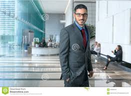 portrait of a successful corporate business man executive in a modern office workplace environment confident stylish business office modern