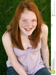 Redhead teen with braces masturbates