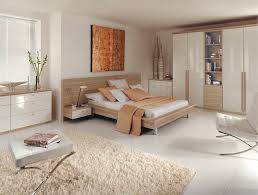 fitted portofino fitted bedroom in high gloss white and granadillo