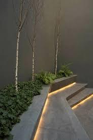 next step lighting. outdoor concrete steps lighting under lights patio plants wood trees next step w