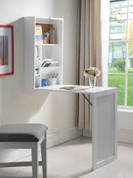 ... for all your art supplies, this desk has compartments to organize all  your goods. The table folds up into a wall-mounted cabinet when not in use,  ...