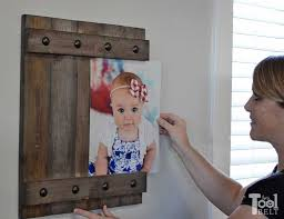 change out your photo prints super easy with a sliding farmhouse style frame make these