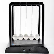 illuminating newtons cradle science physics desktop pendulum
