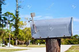metal mailbox flag. A Grey Metal Mailbox Sitting On Post With The Flag Up Side Of U