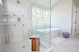 corner shower with white glass tiles