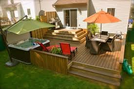 come down a couple steps and then deck hot tub is nice add on patio on c89
