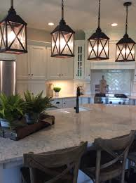 counter kitchen lighting. Cream Painted Cabinetry With Carrara Counter Tops, Classic White Subway Backsplash Herringbone Insert Behind The Stove Top And Lantern Pendants. Kitchen Lighting R