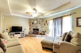 corner fireplace mantels with tv above corner fireplace with above high light brown wooden fireplace between