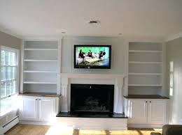 how high to hang tv mounting above gas fireplace