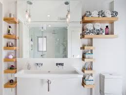 contemporary bathroom with a trough sink bathroom floating organizer bathroom mirror white wall hanging lamps glass