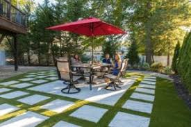 patio pavers with grass in between. Combining Pavers And Turf Is A Great Way To Get Natural Lawn Look With Little Maintenance In High-traffic Areas Like Pool Decks Patios. Patio Grass Between