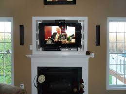image of small tv above the fireplace where to put the cable box