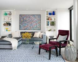 this sleek and modern living room features built shelving that flanks a comfy gray sectional