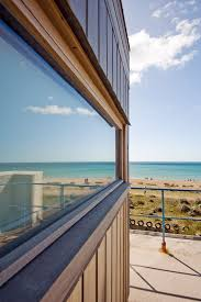 architectural detail photography. Architectural Photographer Edinburgh, Sea Reflected In Window Of Beach Side Property Detail Photography