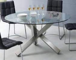 glass and metal furniture. round glass dining table with unique metal base and furniture