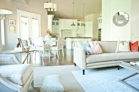 this neutral family room is open to the dining room and kitchen