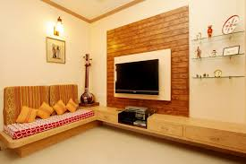 indian living room interior ideas in orange theme with wooden wall decoration and television