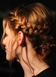 single braided low bun with puffy crown and loose strands
