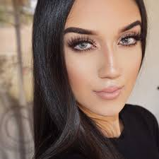 beauty advisor soft glam look highlighted areas light contour long lashes and a creamy