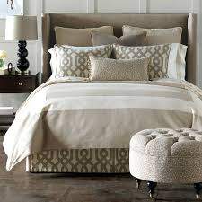 duvet bedding warm white and brown color pillows wood floor small lamp table with drawer duvet