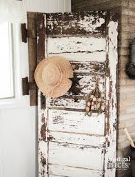 antique chippy white door bees functional decor with the addition of barn beam pegs by prodigal