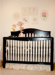 she chose the mercedes crib a convertible crib featuring an old fashioned spindle rail the whisper bedding set designed by nava s designs has an almost