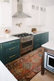 just kitchen designs. love the teal colored lower cabinets and beautiful persian rug that adds just right kitchen designs r