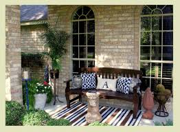 exterior decorating ideas for front entrance. amazing design of the front porch decor with brown wooden sofa added stripes rugs and exterior decorating ideas for entrance